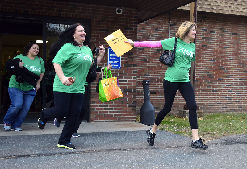 3/12/2016 Mike Orazzi | Staff Wheeler Regional Family YMCA'S seventh annual O 'Mazing Race participants Stacey Boyajian, Rosa Lachance, Cheryl Trovato at the Veterans of Foreign Wars in Plainville Saturday evening.