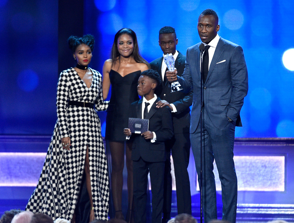 """. Janelle Monae, from left, Naomie Harris, Ashton Sanders, Mahershala Ali, and from front center, Alex R. Hibbert, accept the award for best acting ensemble for \""""Moonlight\"""" at the 22nd annual Critics\' Choice Awards at the Barker Hangar on Sunday, Dec. 11, 2016, in Santa Monica, Calif. (Photo by Chris Pizzello/Invision/AP)"""