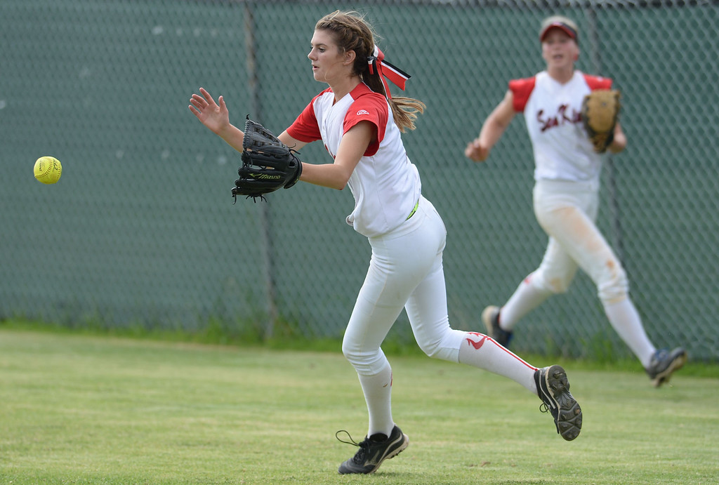 . Palos Verdes\' McKenna Kostrencich scoops-up a St. Paul hit to right field in a CIF-SS Division III semifinal softball game Tuesday, May 27, 2014, Palos Verdes Estates, CA.   Palos Verdes lost 10-0. Photo by Steve McCrank/Daily Breeze