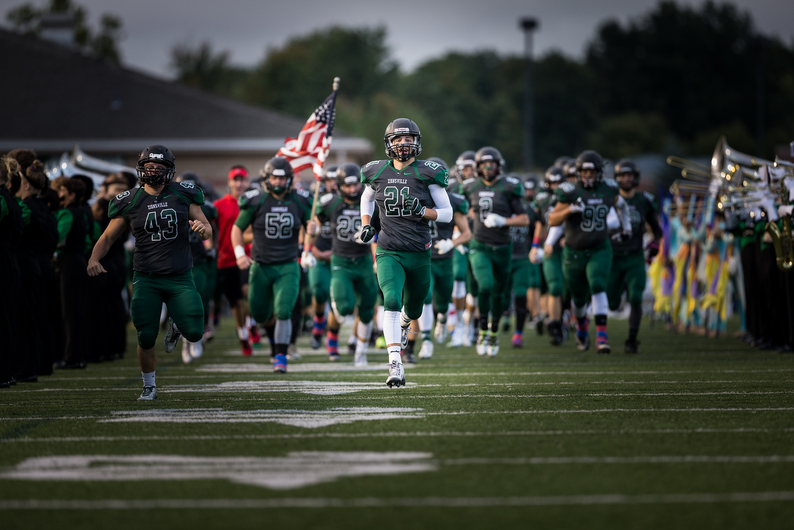 My best football entrance shot. This shot does not work if Scott didn't separate himself from the pack. The flag in the background is a nice touch as well. This one even made the inside cover of the yearbook.