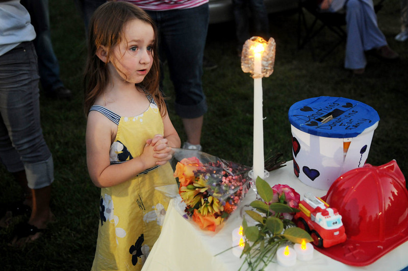 . Samantha Grace Aquino of Clear Lake prays during the candlelight vigil. Her mom explained to her what happened to Isaiah. (Pioneer Press: Jean Pieri)