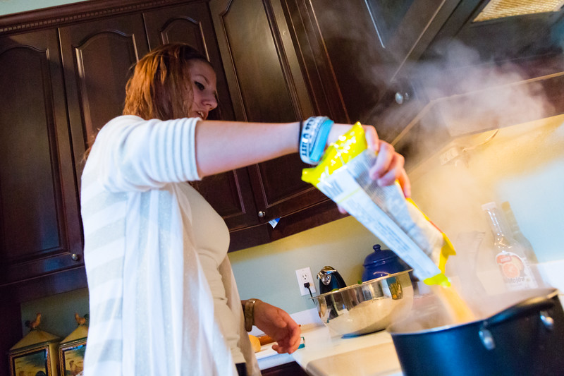 Shelby Sparrow, 21, of Plantation, Florida,  pours the yellow rice into a pot of boiling water. Sparrow is cooking dinner for the residents of All About Recovery's younger women's sober home in Loxahatchee, Florida on Wednesday, June 1, 2016. Sparrow, a recovering heroin addict has been in the sober home since February 2016 and has been clean for five months. (Joseph Forzano / The Palm Beach Post)
