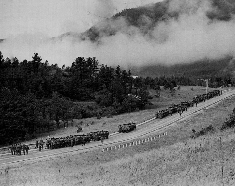 . Columns of Doolies are Marched into Jack\'s Valley The five-mile march took the doolies to where they got camping supplies and learned how to pitch a tent. 1977.  The Denver Post Library Archive