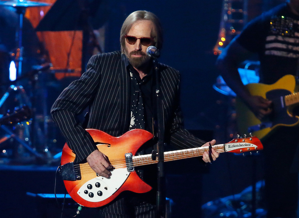 ". Tom Petty performs with ""I Love LA\"" with Randy Newman, not pictured, while Newman is inducted into the Rock and Roll Hall of Fame during the Rock and Roll Hall of Fame Induction Ceremony at the Nokia Theatre on Thursday, April 18, 2013 in Los Angeles. (Photo by Danny Moloshok/Invision/AP)"