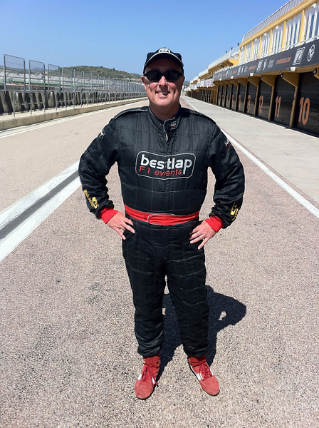 Getting ready to ride in a F1 race car
