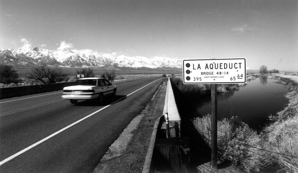 . L.A. Aqueduct flows under section of Highway 395 south of Independence on February 20, 1992.   (Los Angeles Daily News file photo)