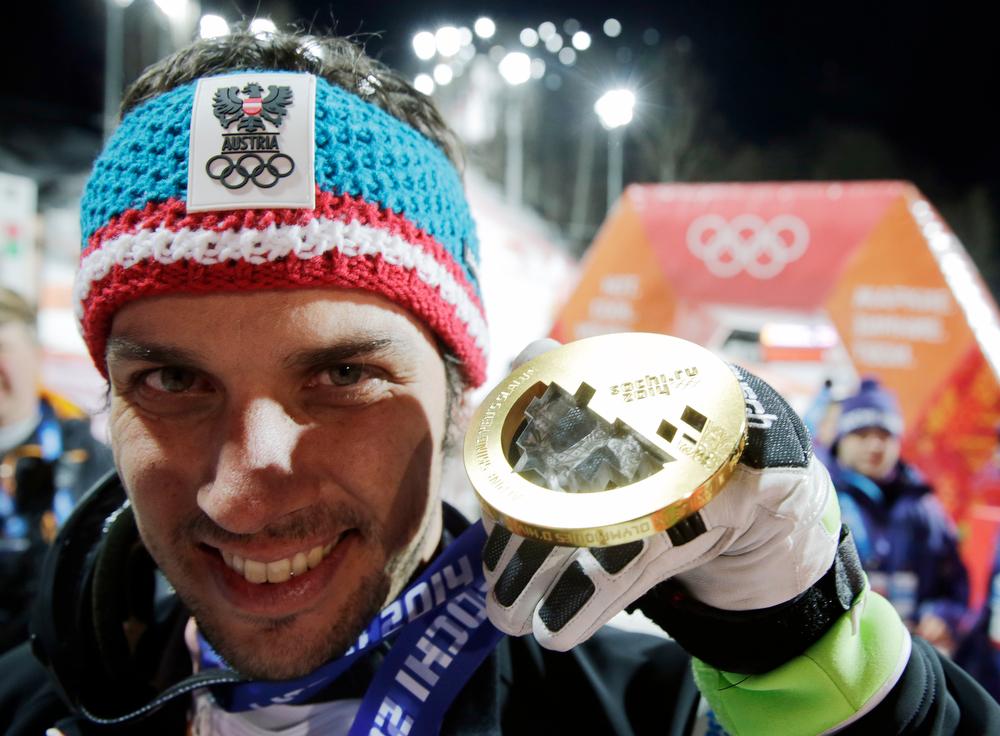 . Men\'s slalom winner Austria\'s Mario Matt holds his gold medal at the Sochi 2014 Winter Olympics, Saturday, Feb. 22, 2014, in Krasnaya Polyana, Russia. (AP Photo/Gero Breloer)