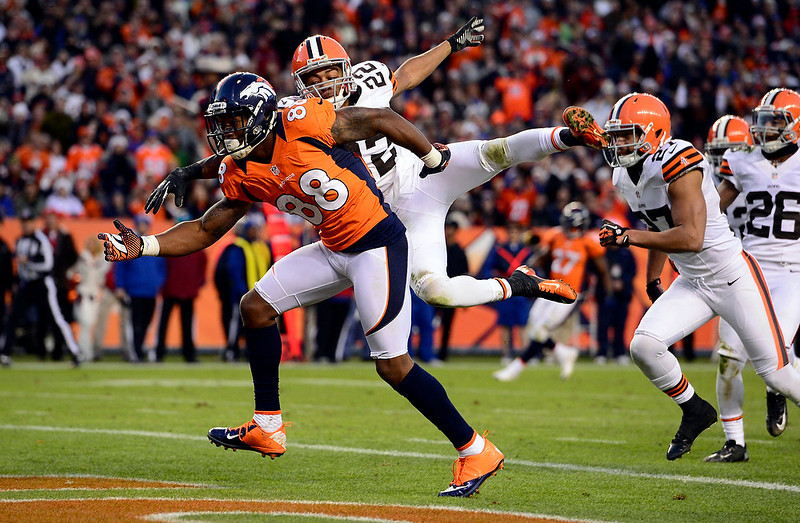 . Denver Broncos wide receiver Demaryius Thomas (88) goes for a pass while Cleveland Browns cornerback Buster Skrine (22) covers in the second half.  The Denver Broncos vs Cleveland Browns at Sports Authority Field Sunday December 23, 2012. AAron Ontiveroz, The Denver Post