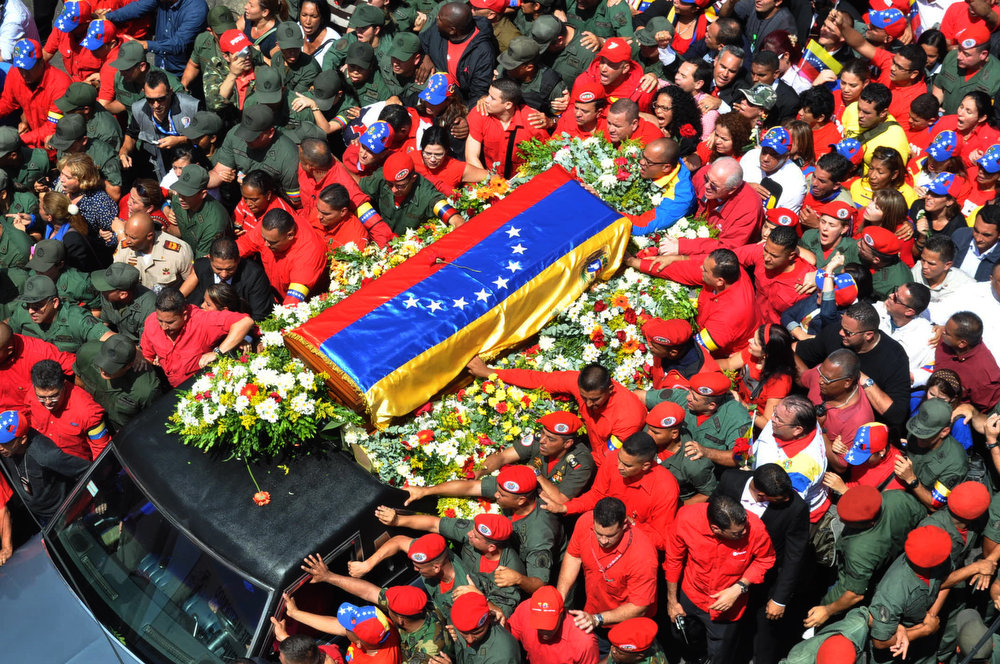 . View of the hearse carrying the coffin of Venezuelan President Hugo Chavez while leaving the Military Hospital to the Military Academy on March 6, 2013 in Caracas. The flag-draped coffin of Venezuelan leader Hugo Chavez was borne through throngs of weeping supporters on Wednesday as a nation bade farewell to the firebrand leftist who led them for 14 years. LUIS CAMACHO/AFP/Getty Images