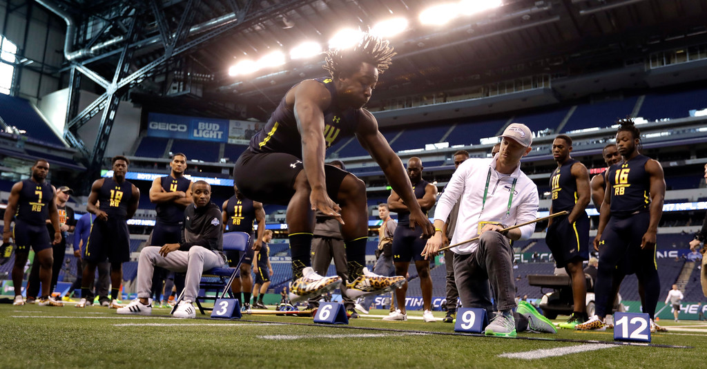 . Toledo running back Kareem Hunt is tested in the broad jump at the NFL football scouting combine Friday, March 3, 2017, in Indianapolis. (AP Photo/David J. Phillip)