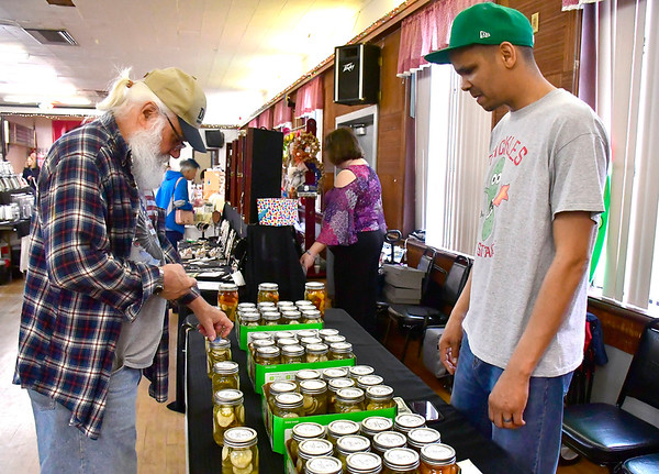 4/20/2019 Mike Orazzi | Staff Larry Zbikowski talks with Jason Stafford during the Mum Festival's 2nd Annual Spring Fling Craft Fair held at the Bristol Polish American Club in Bristol on Saturday.