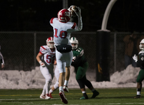 12/04/19 Wesley Bunnell | StaffrrBerlin was defeated by Maloney in a playoff game at Falcon Field in Meriden on Wednesday night. Joseph Caracoglia (10) leaps for a catch.