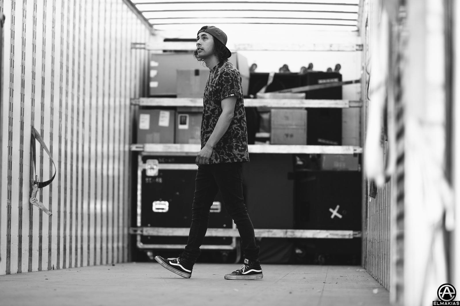 Vic Fuentes of Pierce the Veil inside a semi at Warped Tour 2015 by Adam Elmakias