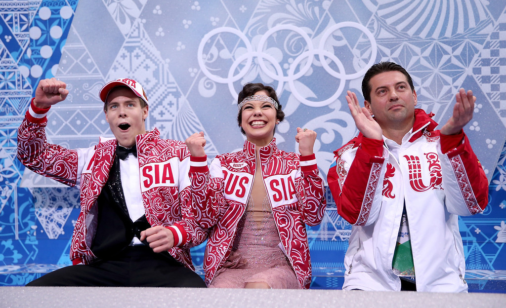 . Elena Ilinykh (C) and Nikita Katsalapov (L) of Russia react after their score displayed during the Figure Skating Ice Dance Short Dance on day 9 of the Sochi 2014 Winter Olympics at Iceberg Skating Palace on February 16, 2014 in Sochi, Russia.  (Photo by Matthew Stockman/Getty Images)