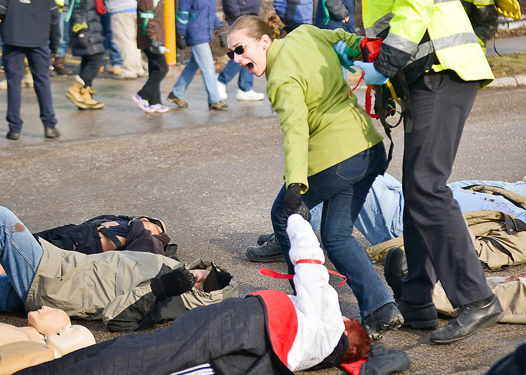 """. \""""Mom!\"""" yells a woman as she\'s dragged away from the triage area during a full-scale emergency preparedness exercise. (Pioneer Press: Ben Garvin)"""