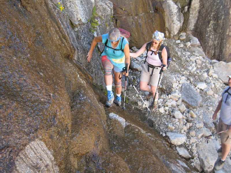 after tanking up for the last time - Alice and Tara crossing the waterfall below EF Lake