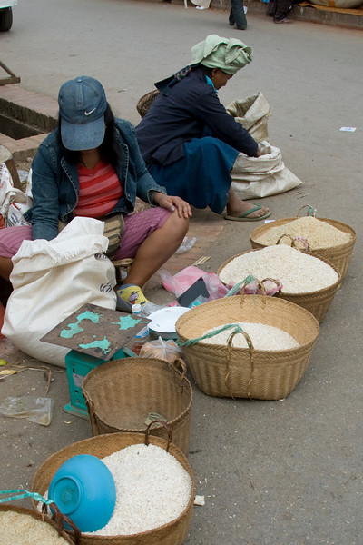 Rice vendors at a market in Luang Prabang, Laos