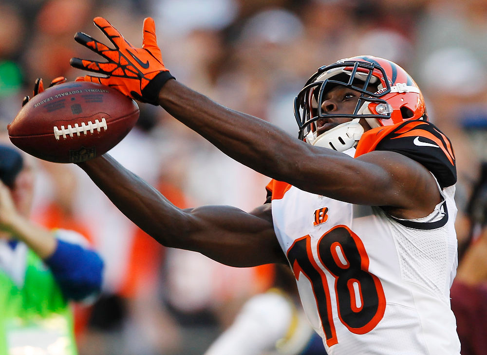 Description of . Cincinnati Bengals wide receiver A.J. Green drops a pass during the second half of an NFL football game against the San Diego Chargers, Sunday, Dec. 2, 2012, in San Diego. (AP Photo/Lenny Ignelzi )