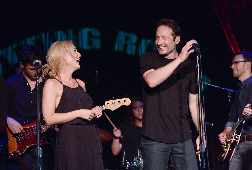 ". David Duchovny is joined by actress Gillian Anderson during his performance at The Cutting Room, in support of the release of his debut album ""Hell Or Highwater\"", on Tuesday, May 12, 2015, in New York. (Photo by Evan Agostini/Invision/AP)"