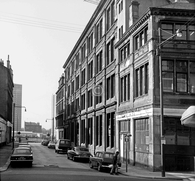 Buchan St, south of Oxford St.   The main building here was a brass works built in 1890 for John Wilson & Son, brass and bell founders.    September 1973