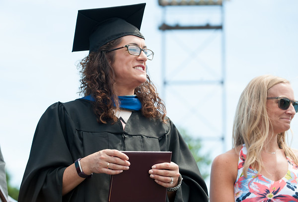 06/19/18 Wesley Bunnell | Staff New Britain High School Acting Principal Kerry-Lynn Major holds a diploma during graduation exercises at Veterans' Memorial Stadium at Willow Brook Park on Tuesday morning.