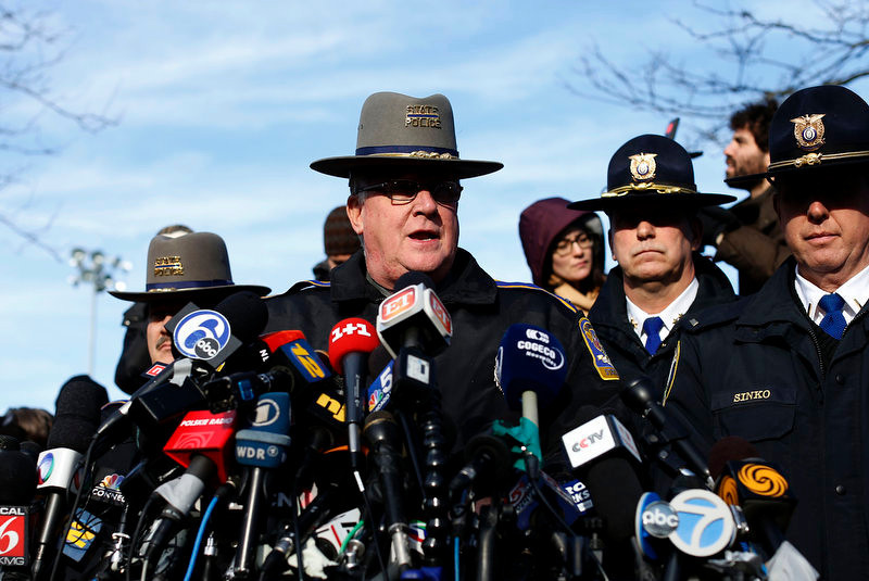 . Lt. J. Paul Vance of the Connecticut State Police conducts a news briefing, Saturday, Dec. 15, 2012 in Newtown, Conn. The massacre of 26 children and adults at Sandy Hook Elementary school elicited horror and soul-searching around the world even as it raised more basic questions about why the gunman, 20-year-old Adam Lanza, would have been driven to such a crime and how he chose his victims. (AP Photo/Jason DeCrow)