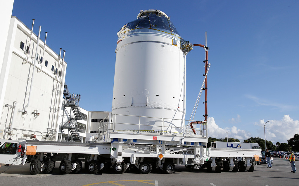 . In this Sept. 11, 2014 photo, NASA\'s Orion spacecraft, preparing for it\'s first flight, departs the Neil Armstrong Operations and Checkout Building on its way to the Payload Hazardous Servicing Facility at the Kennedy Space Center in Cape Canaveral, Fla. Officials said Thursday, Nov. 6, 2014, that everything looks good for the Dec. 4 launch of NASAís new Orion capsule(AP Photo/John Raoux, File)