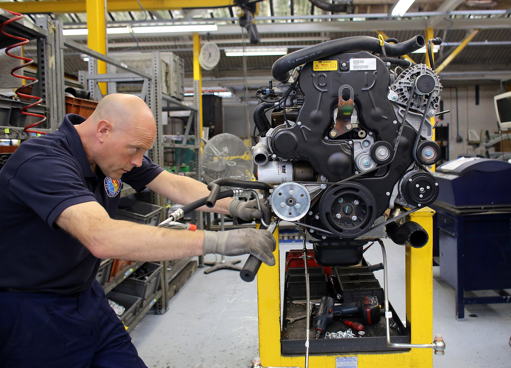 . Steve Jenkins works on a TX4 (Euro 5) London Taxi on the assembly line inside the factory of the London Taxi Company on September 11, 2013 in Coventry, England.  (Photo by Matt Cardy/Getty Images)