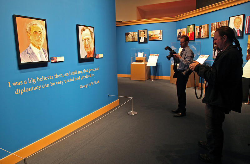 . Members of the media take photographs inside the George W. Bush Presidential Library and Museum for a preview of the art painted by former president George W. Bush. (Photo by Stewart F. House/Getty Images)