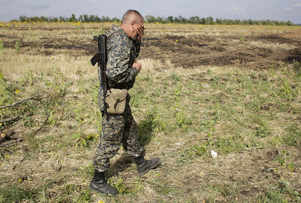 . TOPSHOTS A Ukrainian soldier walks in a field as he guards at a checkpoint controlled by Ukrainian forces on September 10, 2014, near the small eastern Ukrainian city of Slavyanoserbsk, in the Lugansk region. AFP PHOTO/ ANATOLII STEPANOVANATOLII STEPANOV/AFP/Getty Images