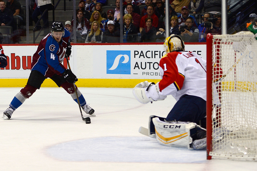 . DENVER, CO - MARCH 3: Colorado Avalanche defenseman Tyson Barrie (4) looks for an opening around Florida Panthers goalie Roberto Luongo (1) during the first period at the Pepsi Center on March 3, 2016 in Denver, Colorado. (Photo by Brent Lewis/The Denver Post)
