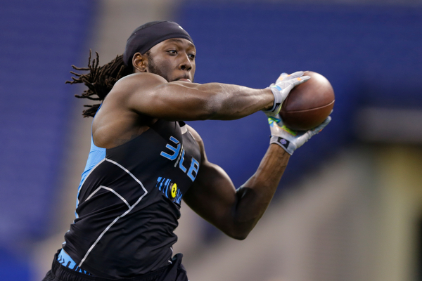 . Louisiana State linebacker Lamin Barrow runs a drill at the NFL football scouting combine in Indianapolis, Monday, Feb. 24, 2014. (AP Photo/Michael Conroy)