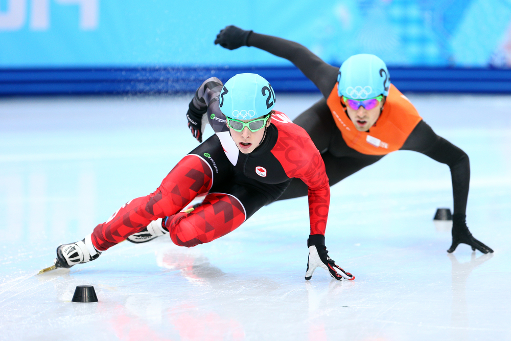. Charle Cournoyer of Canada and Freek Van Der Wart of the Netherlands compete in the Short Track Men\'s 500m Heat at Iceberg Skating Palace on day 11 of the 2014 Sochi Winter Olympics on February 18, 2014 in Sochi, Russia.  (Photo by Paul Gilham/Getty Images)