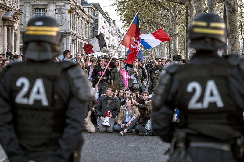 """. Supporters of the anti-gay marriage movement \""""La Manif Pour Tous\"""" (Demonstration for all!) face anti-riot policemen as they demonstrate on April 23, 2013 in Lyon, southeastern France, some hours after the French National Assembly adopted a bill legalizing same-sex marriages and adoptions for gay couples, defying months of opposition protests. In its second and final reading, a majority of lawmakers approved the bill by a vote of 331 to 225.   JEFF PACHOUD/AFP/Getty Images"""