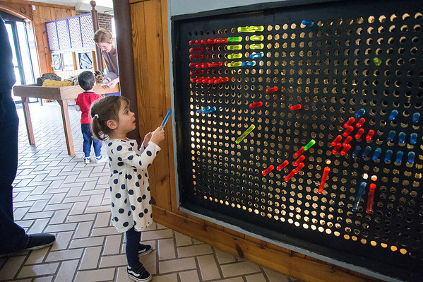 02/10/20 Wesley Bunnell | StaffrrFinley Colone, age 2, uses colored tubes to create patterns at the Youth Museum at Hungerford Park on Wednesday afternoon.