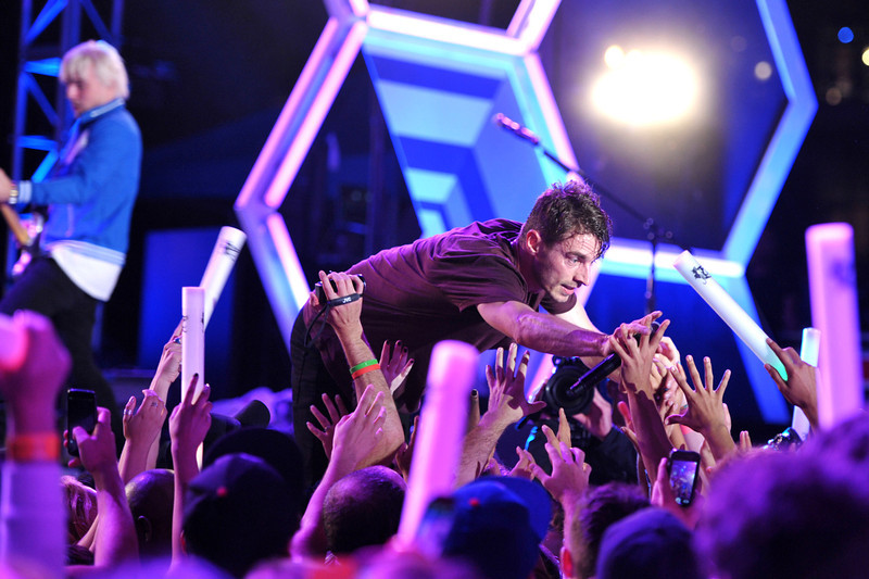. David Boyd of the band New Politics performs at MTV2\'s Party in the Park on Day 2 of Comic-Con International on Thursday, July 18, 2013 in San Diego, Calif. (Photo by John Shearer/Invision for MTV2/AP Images)