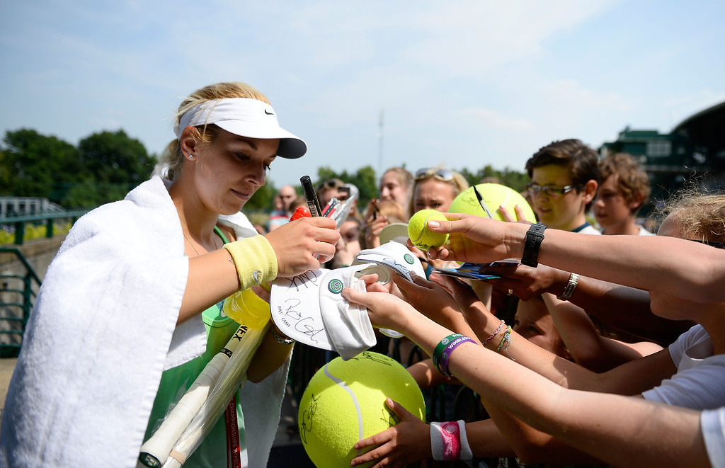 . LONDON, ENGLAND - JULY 05:  Sabine Lisicki of Germany signs autographs for fans after a practice session on day eleven of the Wimbledon Lawn Tennis Championships at the All England Lawn Tennis and Croquet Club on July 5, 2013 in London, England.  (Photo by Dennis Grombkowski/Getty Images)