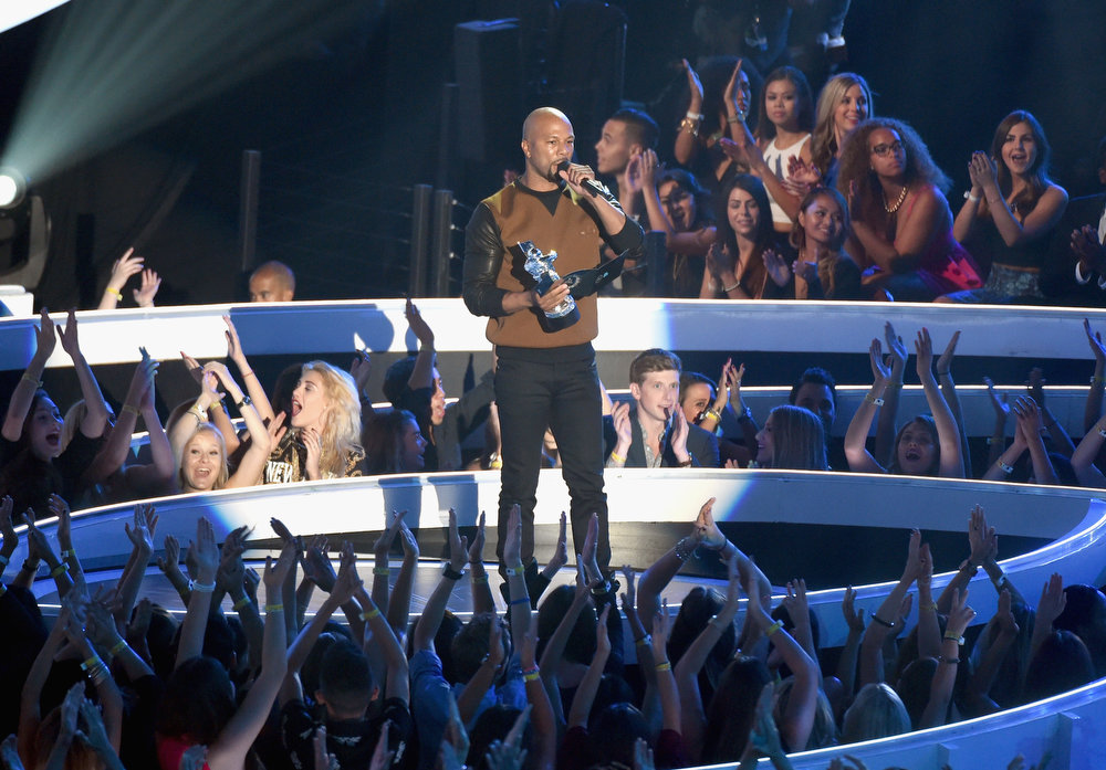 . Recording artist/actor Common speaks onstage during the 2014 MTV Video Music Awards at The Forum on August 24, 2014 in Inglewood, California.  (Photo by Michael Buckner/Getty Images)