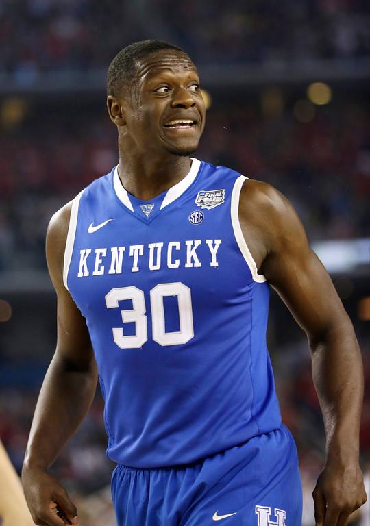 . Kentucky forward Julius Randle reacts during the first half of an NCAA Final Four tournament college basketball semifinal game against Wisconsin Saturday, April 5, 2014, in Arlington, Texas. (AP Photo/David J. Phillip)
