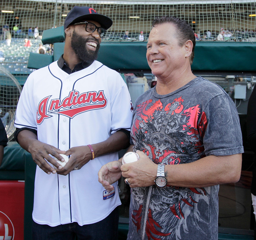 ". Cleveland Cavaliers Baron Davis, left, shares a laugh with WWE wrestling star Jerry ""The King\"" Lawler on the field for pregame activities before a baseball game between the Cleveland Indians and the Texas Rangers in Cleveland on Thursday, June 2, 2011.   (AP Photo/Amy Sancetta)"