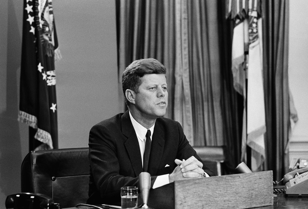 . President John Kennedy as he made a nation-wide televised broadcast on civil rights in the White House, June 11, 1963.  His talk occurred the day Alabama Gov. George Wallace defied a federal court order to admit two black students to the University of Alabama at Tuscaloosa.  Wallace withdrew after the National Guard was federalized and placed on duty on the university campus.  The president asked the American people for help in ending racial discrimination and termed the fulfillment of African American rights a moral issue. Kennedy spoke from his office.  (AP Photo/Charles Gorry)