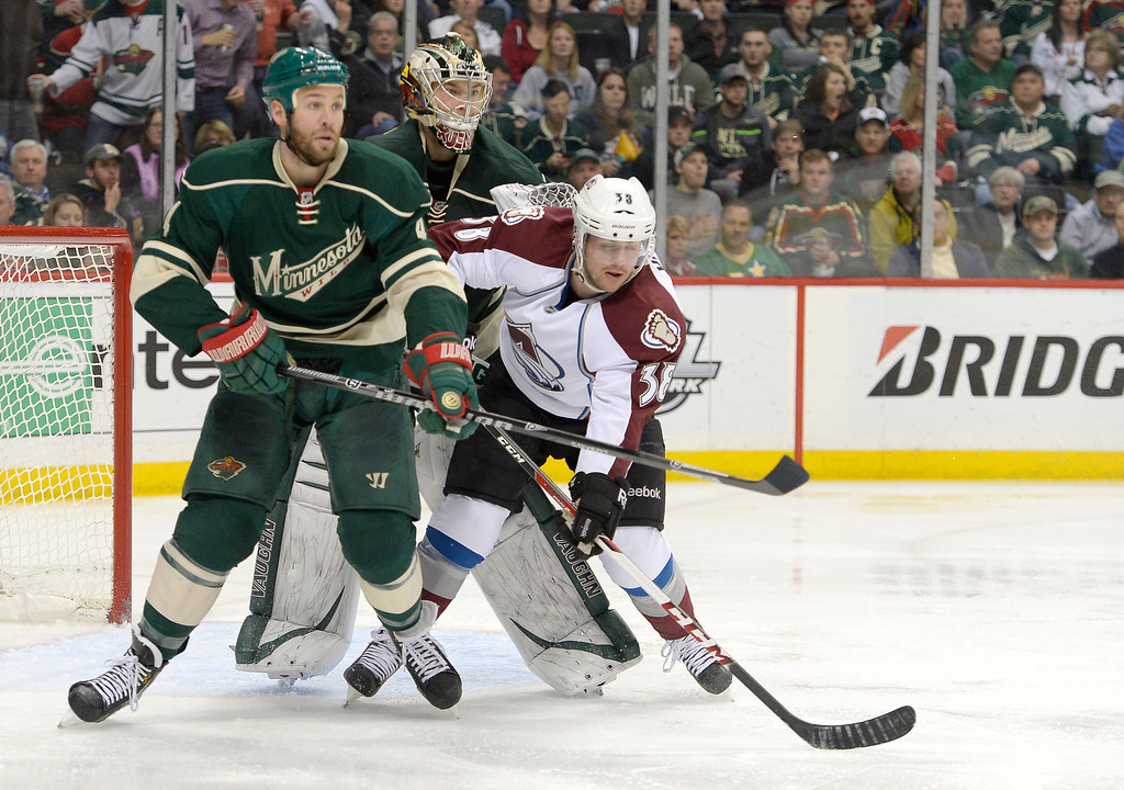 . Colorado Avalanche center Joey Hishon (38) gets hit from Minnesota Wild goalie Darcy Kuemper (35) as he stands near the crease during the second period April 24, 2014 in Game 4 of the Stanley Cup Playoffs at Xcel Energy Center. Minnesota Wild defenseman Clayton Stoner (4) also in on defense. (Photo by John Leyba/The Denver Post)