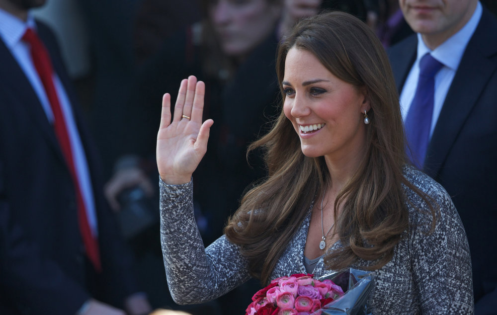 Description of . Britain's Catherine, Duchess of Cambridge, waves as she leaves Hope House charity in south London on February 19, 2013. The Duchess visited Hope House, an all-female rehabilitation centre which is is one of the projects run by her patronage, Action on Addiction.  ANDREW COWIE/AFP/Getty Images