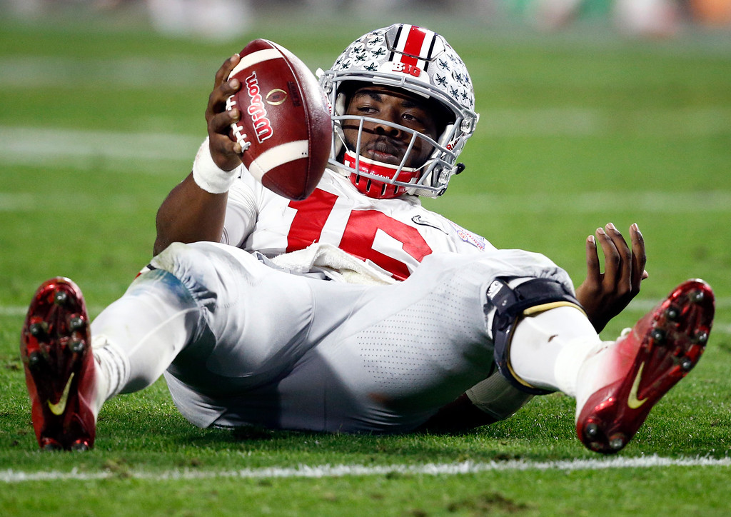 . Ohio State quarterback J.T. Barrett looks to the sideline bench after being sacked bu Clemson during the second half of the Fiesta Bowl NCAA college football playoff semifinal, Saturday, Dec. 31, 2016, in Glendale, Ariz. (AP Photo/Ross D. Franklin)
