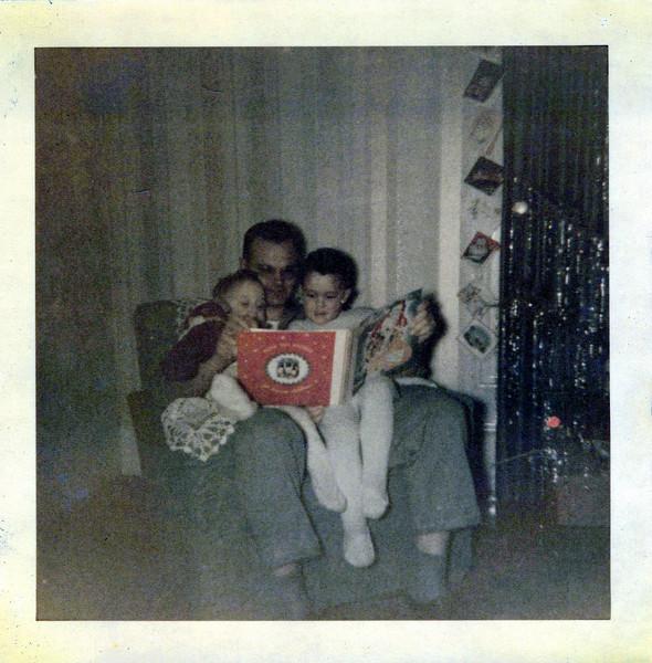 Christmas 1951 Doc reading to Ken and Butch.jpeg