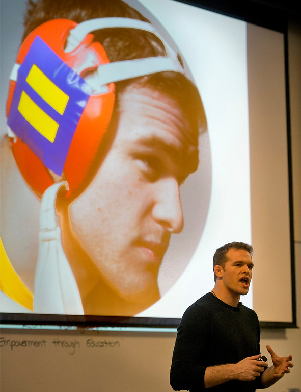 . Former All-American college wrestler and current Columbia University wrestling coach Hudson Taylor speaks to Whittier College students about homophobia in sports March 13, 2013.   The projected image shows Taylor as a college wrestler wearing the Human Rights Campaign logo supporting LGBT rights and awareness on his wrestling ear protector.  (SGVN/Staff photo by Leo Jarzomb)