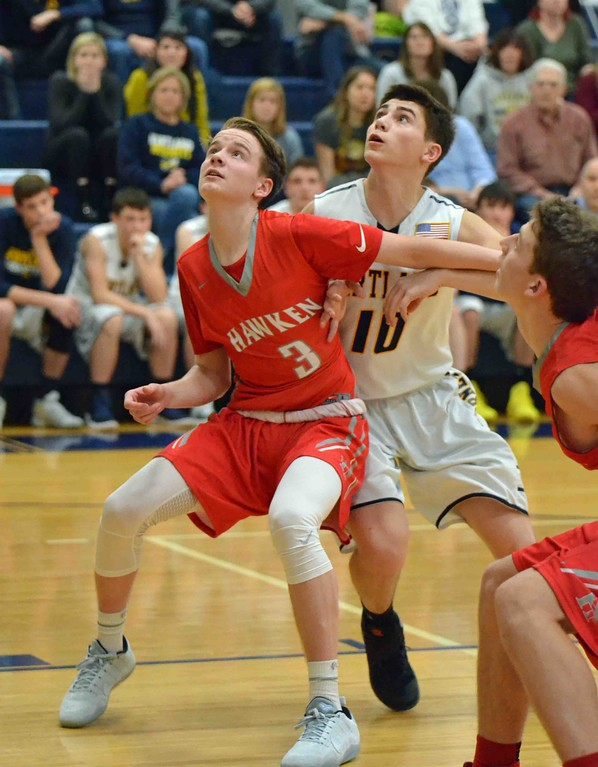 . Paul DiCicco - The News-Herald Hawken�s Brenden Paul boxes out a Kirtland defender late in the fourth quarter.