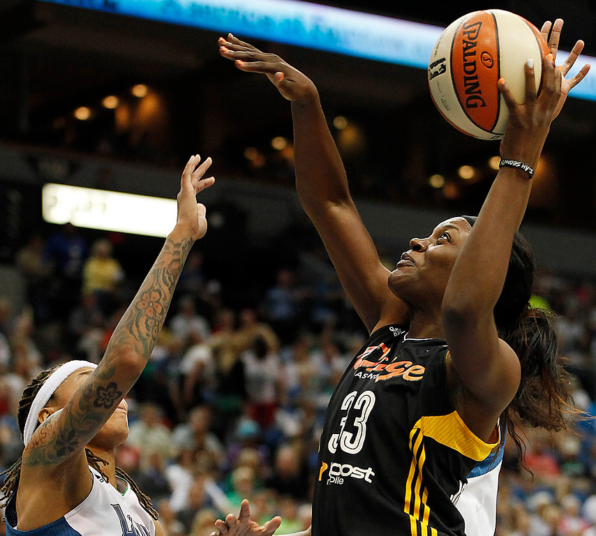 . Tulsa Shock forward Tiffany Jackson-Jones, right, goes to the basket against guard Minnesota Lynx Seimone Augustus, left, in the first half. (AP Photo/Stacy Bengs)