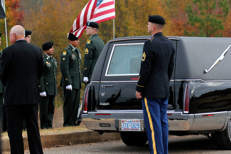 The Honor Guard prepares to carry Staff SGT Chris Newman's casket.