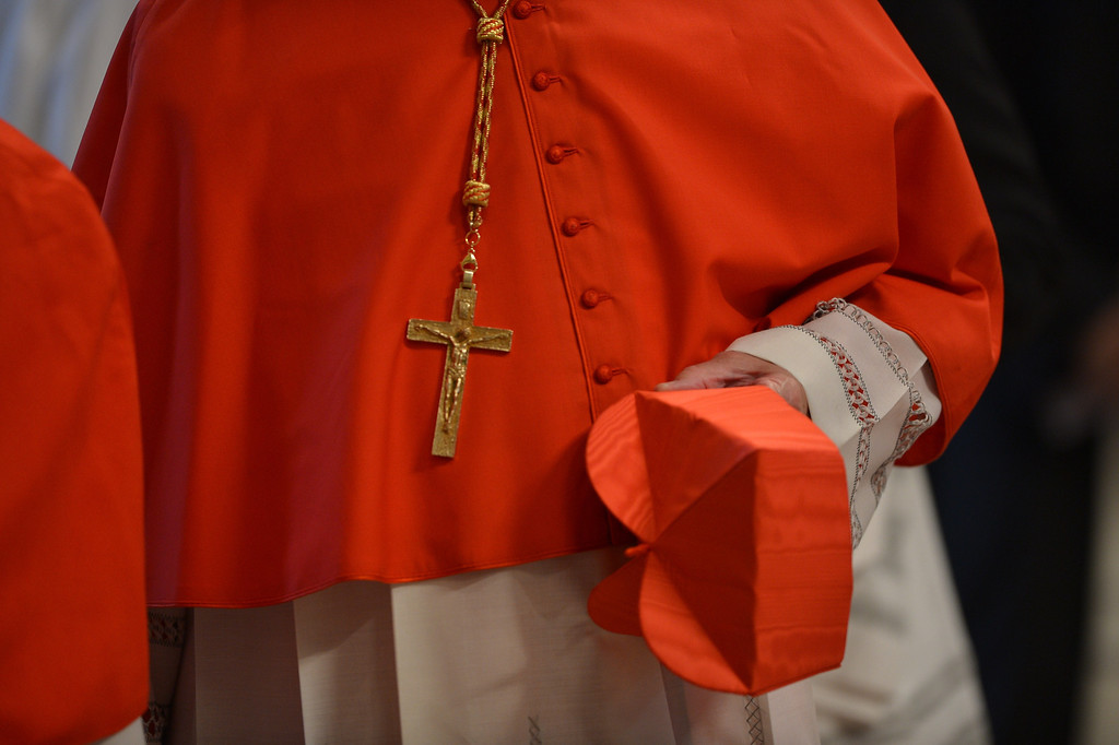 . A cardinal holds his berretta during a mass at the St Peter\'s basilica before the conclave on March 12, 2013 at the Vatican. AFP PHOTO / GABRIEL BOUYS/AFP/Getty Images